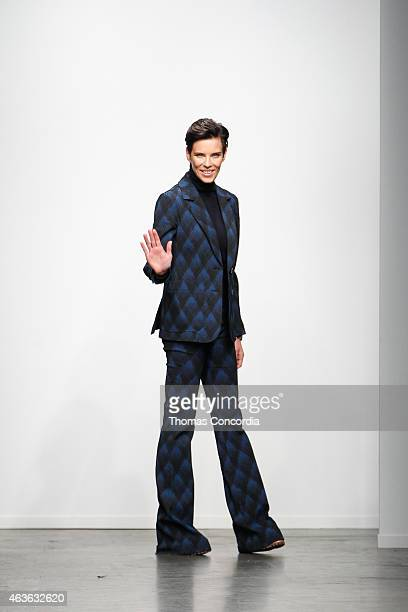 Karen Walker greets the audience after presenting the Karen Walker Fall 2015 collection during Mercedes-Benz Fashion Week at Pier 59 on February 16,...