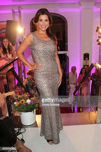 Karen Webb attends the Susanne Wiebe fashion show 'Upgrade Your Self' on August 8 2014 in Munich Germany