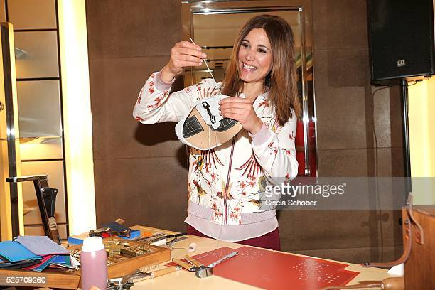 Karen Webb sews a shoe during the TOD'S 'The art of leather' party on April 28 2016 in Munich Germany