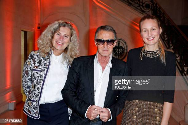 Karen with her husband Eric Pfrunder and their daughter Candice Rummo are photographed for Paris Match at the evening gala Sauver La Vie for the...