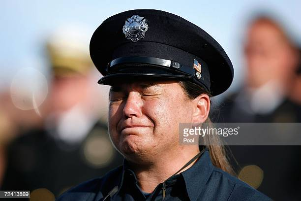 Karen Zakowicz of Los Angeles County Fire Services grieves at the memorial service for five US Forest Service firefighters on November 5 2006 in San...