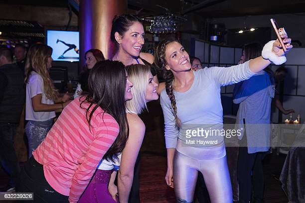 Karena Dawn and Katrina Scott pose for a selfie with guests in the Tone It Up Wellness Lounge during the Sundance Film Festival on January 20, 2017...