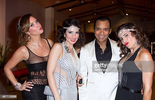 Karent Sierra Jon Secada and Mari Secada attends Dress for Success Miami Celebrates 20th Anniversary at The Rusty Pelican>> on October 11 2014 in Key...