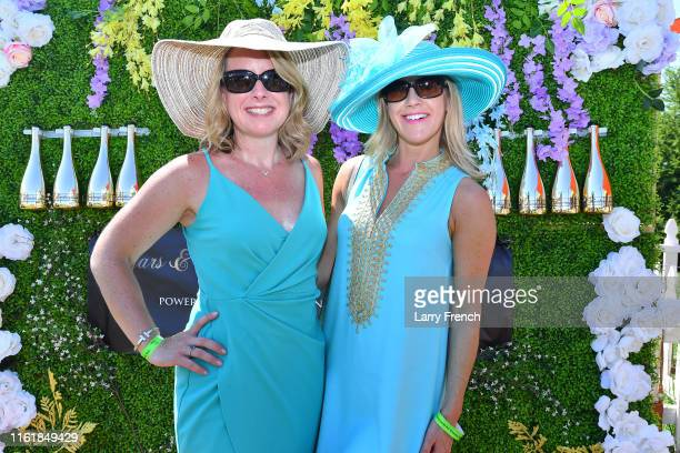 Karer Hynes and Claudia Rzebka are seen at Grandiosity Events CigarsGuitars Charity PoloJazz charity event Powered by Logical Technology and Research...