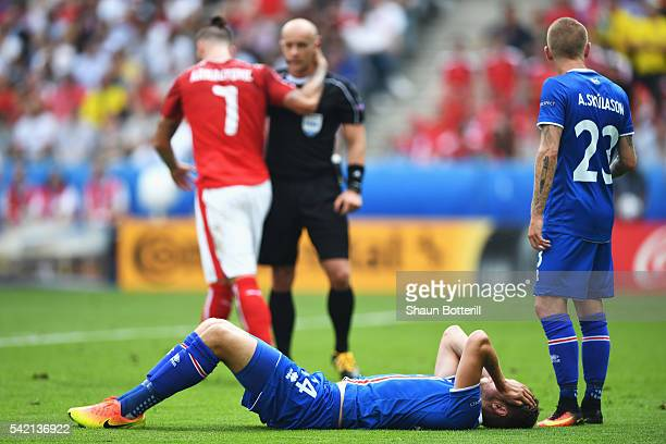 Kari Arnason of Iceland and Ari Skulason of Iceland react to the decision to award a penalty against them during the UEFA EURO 2016 Group F match...