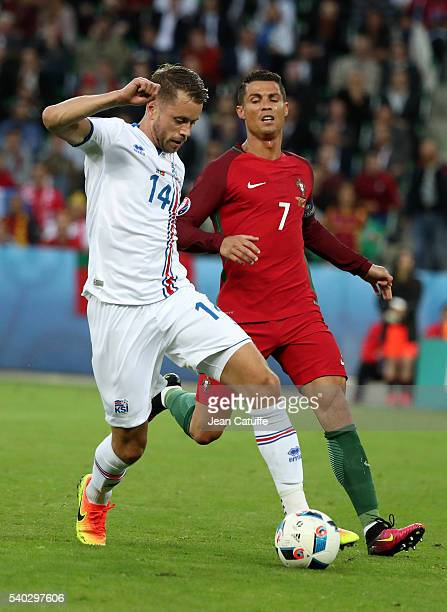 Kari Arnason of Iceland and Cristiano Ronaldo of Portugal in action during the UEFA EURO 2016 Group F match between Portugal and Iceland at Stade...