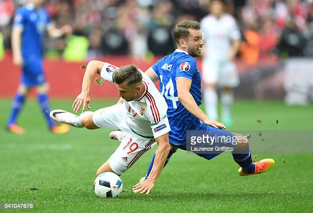 Kari Arnason of Iceland and Tamas Priskin of Hungary compete for the ball during the UEFA EURO 2016 Group F match between Iceland and Hungary at...