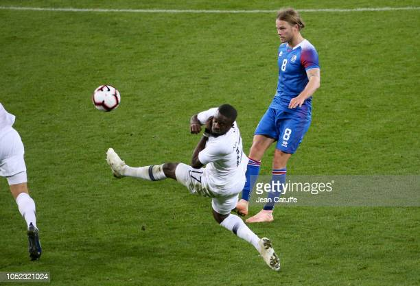 Kari Arnason of Iceland Tanguy Ndombele of France during the international friendly match between France and Iceland at Stade de Roudourou on October...