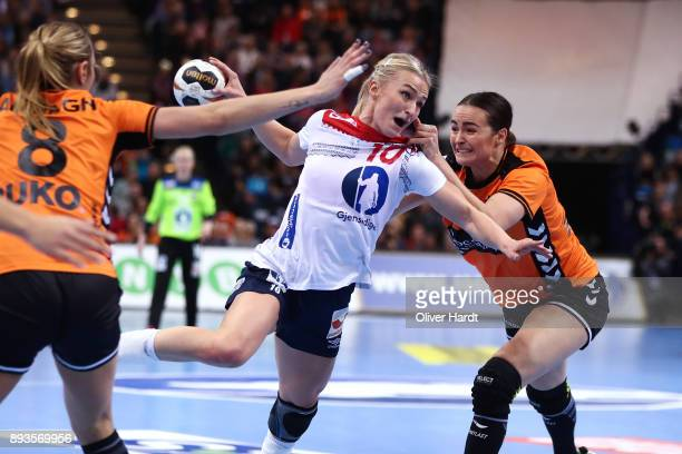Kari Brattset of Netherlands and Stine Bredal Oftedal of Norway challenges for the ball during the Championship Semi Final between match between...