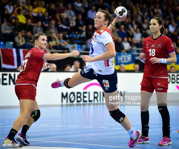Kari Brattset of Norway scores a goal during IHF Women's Handball World Championship group B match between Czech Republic and Norway on December 07...