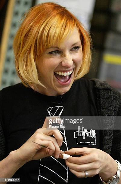 Kari Byron laughs at a remark as she works on dart tips for her blowpipe in preparation for the upcoming ninja myth segment for the cable television...