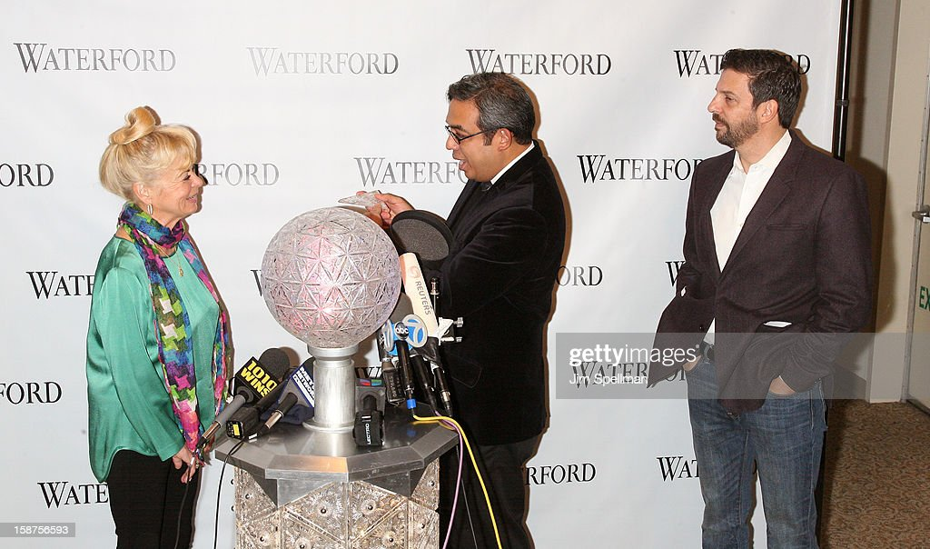 Kari Clark, Waterford senior brand director Regan glesia Times Square Alliance President Tim Tompkins attend the installation of 288 New Waterford Crystals on the 2013 Times Square New Year's Eve Ball at One Times Square on December 27, 2012 in New York City.