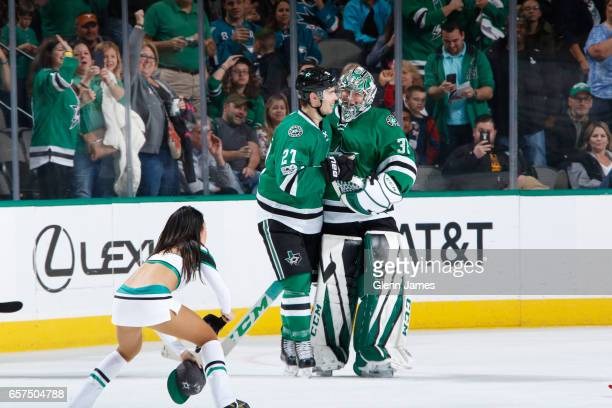 Kari Lehtonen and Adam Cracknell of the Dallas Stars celebrate a goal for his first career hattrick against the San Jose Sharks at the American...