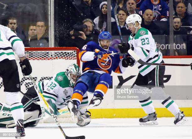 Kari Lehtonen and Esa Lindell of the Dallas Stars defend against Andrew Ladd of the New York Islanders during the first period at the Barclays Center...