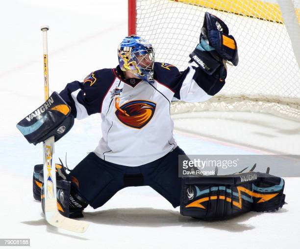 Kari Lehtonen of the Atlanta Thrashers makes a glove save during a NHL game against the Detroit Red Wings at Joe Louis Arena January 15 2008 in...