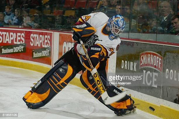 Kari Lehtonen of the Chicago Wolves shoots the puck up the boards against the Hamilton Bulldogs during the American Hockey League game at Copps...