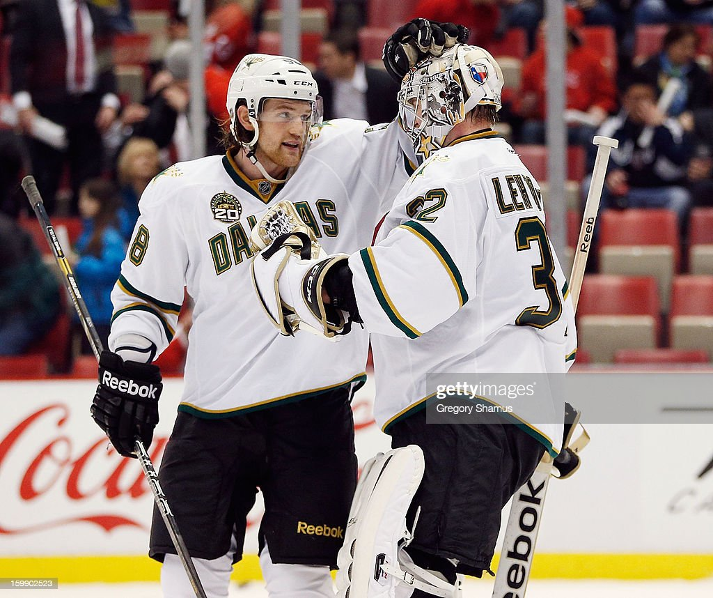 Kari Lehtonen #32 of the Dallas Stars celebrates a 2-1 victory over the Detroit Red Wings with Jordie Benn #58 at Joe Louis Arena on January 22, 2013 in Detroit, Michigan.