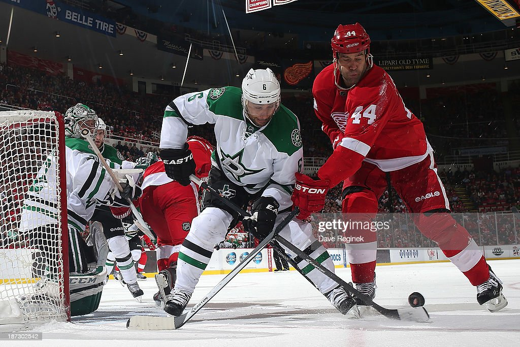 Kari Lehtonen #32 of the Dallas Stars covers the post as teammate Trevor Daley #6 battles for the puck with Todd Bertuzzi #44 of the Detroit Red Wings during an NHL game at Joe Louis Arena on November 7, 2013 in Detroit, Michigan. Dallas defeated Detroit 4-3 in OT