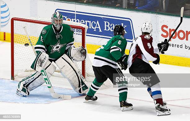 Kari Lehtonen of the Dallas Stars deflects a shot against Matt Duchene of the Colorado Avalanche in the third period at American Airlines Center on...