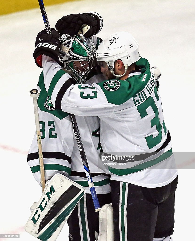 Kari Lehtonen #32 of the Dallas Stars (L) gets a hug from teammate John Klingberg #3 after a win against the Chicago Blackhawks at the United Center on February 11, 2016 in Chicago, Illinois. The Stars defeated the Blackhawks 4-2.