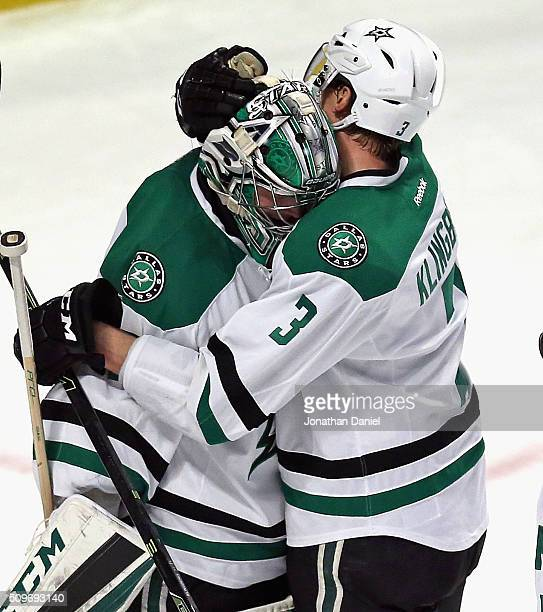 Kari Lehtonen of the Dallas Stars gets a hug from teammate John Klingberg after a win against the Chicago Blackhawks at the United Center on February...