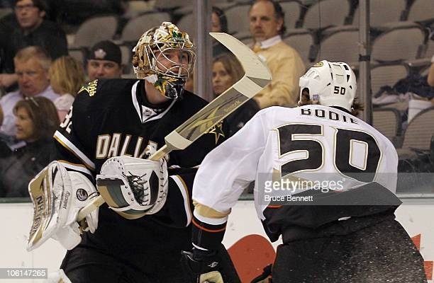 Kari Lehtonen of the Dallas Stars gets the stick up on Troy Bodie of the Anaheim Ducks at the American Airlines Center on October 26 2010 in Dallas...