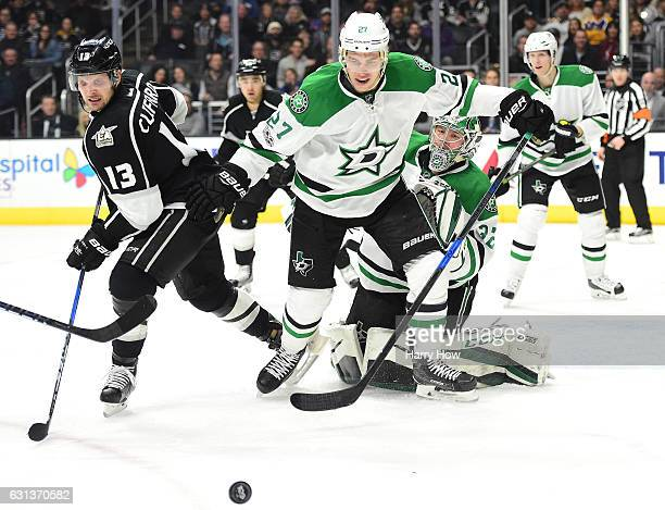 Kari Lehtonen of the Dallas Stars looks for the rebound behind Adam Cracknell and Kyle Clifford of the Los Angeles Kings during the second period at...