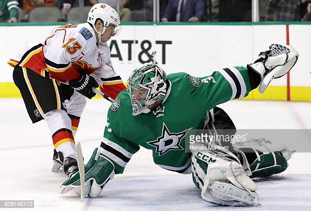 Kari Lehtonen of the Dallas Stars makes a save against Johnny Gaudreau of the Calgary Flames in the second period at American Airlines Center on...