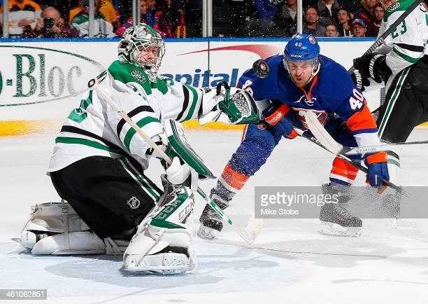 Kari Lehtonen of the Dallas Stars makes a save against Michael Grabner of the New York Islanders at Nassau Veterans Memorial Coliseum on January 6...
