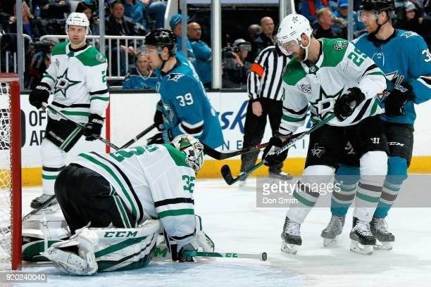 Kari Lehtonen of the Dallas Stars makes a save as Greg Pateryn of the Dallas Stars looks during a game against the San Jose Sharks at SAP Center on...