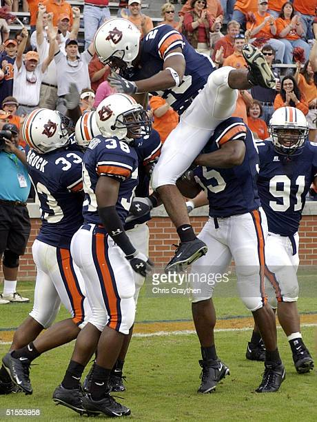 Karibi Dede jumps on Kevis Burnam of the Auburn Tigers after he scored a touchdown on a fumble by Andre Woodson of the Kentucky Wildcats on October...