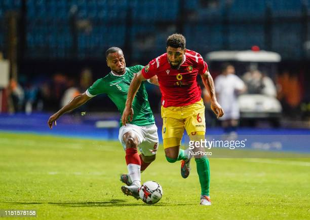Karim Abdoul Nizigiyimana of Burundi and Falette Simon Augustin of Guinea challenging for the ball during the African Cup of Nations match between...