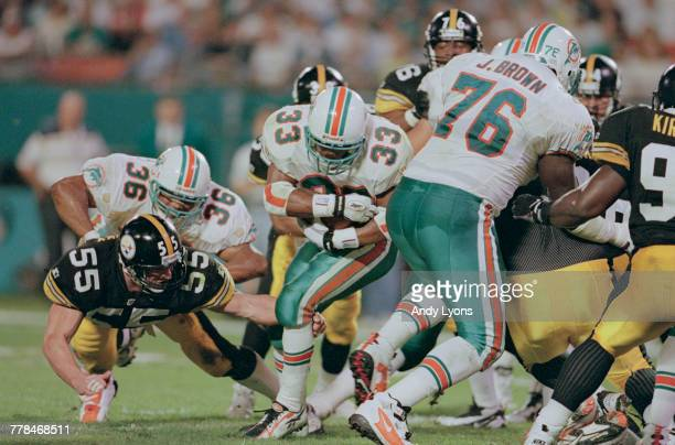Karim AbdulJabbar Running Back for the Miami Dolphins carries the ball on a play during the American Football Conference East game against the...
