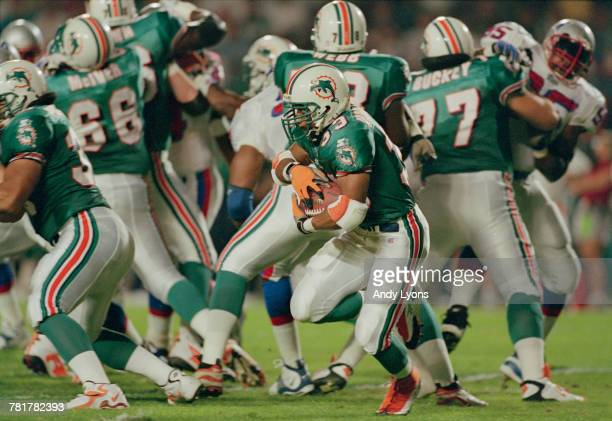 Karim AbdulJabbar Running Back for the Miami Dolphins carries the ball on a play during the American Football Conference East game against the New...