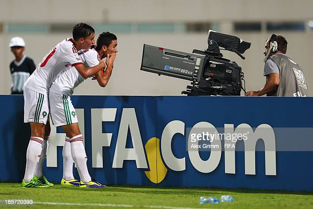 Karim Achahbar of Morocco celebrates his team's fourth goal with team mate Bilal Jellal during the FIFA U17 World Cup UAE 2013 Group C match between...