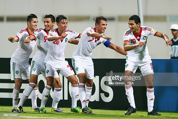 Karim Achahbar of Morocco celebrates his team's fourth goal with team mates Taoufiq Naciri Bilal Jellal Nabil Jaadi and Walid Sabbar during the FIFA...