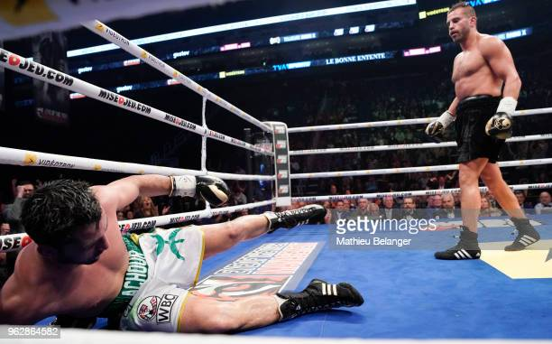 Karim Achour of France falls after being punched by David Lemieux of Canada during their middleweight fight at the Videotron Center on May 26 2018 in...
