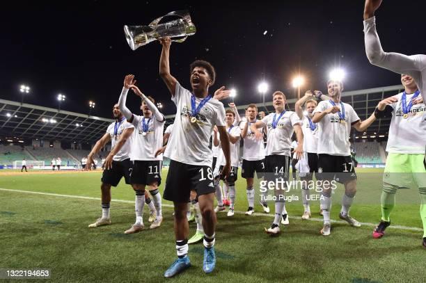 Karim Adeyemi of Germany celebrates with the UEFA European Under-21 Championship trophy following victory in the 2021 UEFA European Under-21...