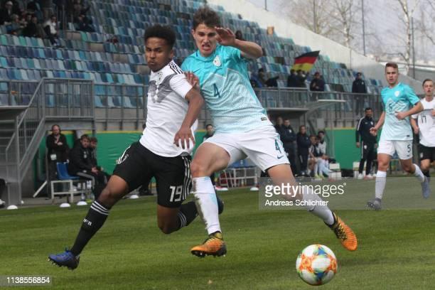 Karim Adeyemi of Germany U17 challenges Laci Ziga of Slovenia U17 during the Uefa Elite Round game between Germany U17 and Slovenia U17 on March 26...