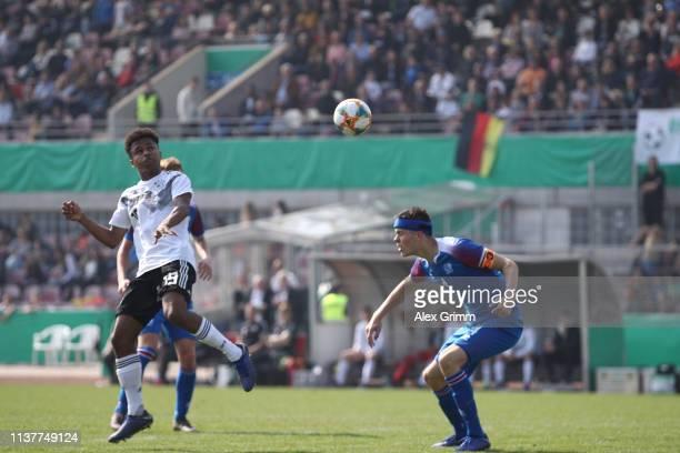 Karim Adeyemi of Germany U17 is challenged by Oliver Stefansson of Iceland U17 during the UEFA Elite Round match between Germany U17 and Iceland U17...