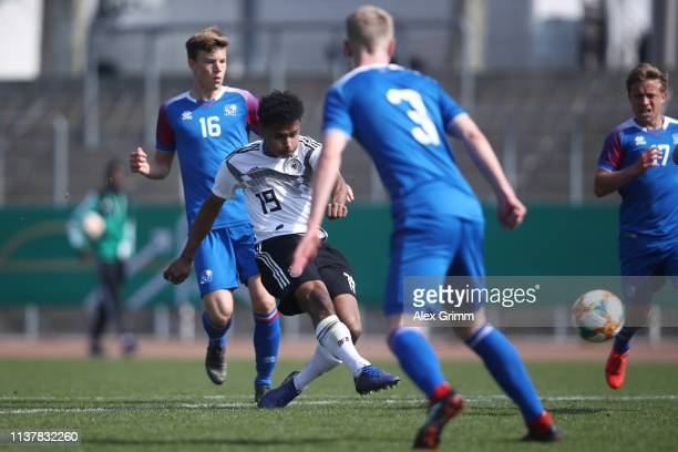 Karim Adeyemi of Germany U17 scores his team's first goal during the UEFA Elite Round match between Germany U17 and Iceland U17 at EWR Arena on March...