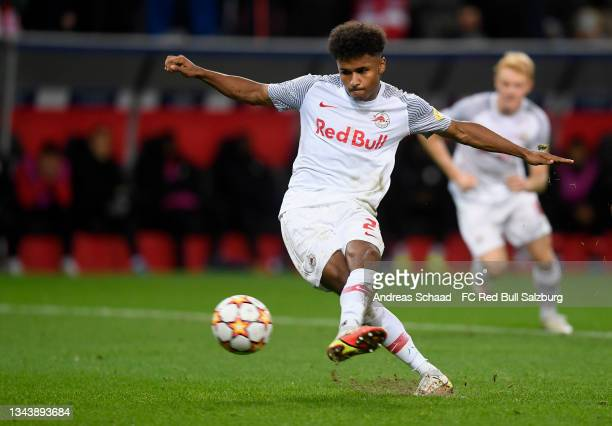 Karim Adeyemi of Red Bull Salzburg takes a penalty shot to score the 1-0 during the UEFA Champions League group G match between FC Red Bull Salzburg...