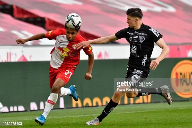 Karim Adeyemi of Salzburg and Tarik Muharemovic of Wolfsberg battle for the ball during the tipico Bundesliga match between RB Salzburg and...