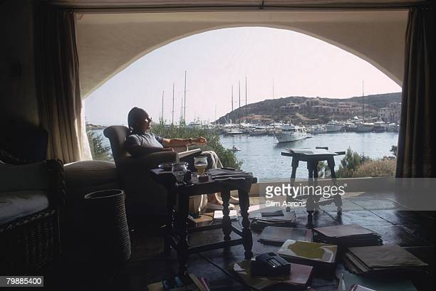Karim alHussayni Aga Khan IV enjoys a view over a harbour on the Costa Smeralda Sardinia August 1978