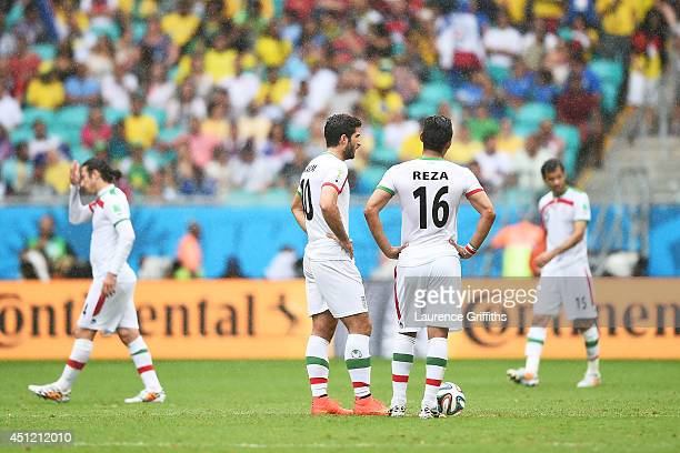 Karim Ansari Fard and Reza Ghoochannejhad of Iran wait to kick off after a goal during the 2014 FIFA World Cup Brazil Group F match between Bosnia...