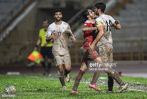 Karim Ansari Fard of Iran argues with Alaa Al Shbbli of Syria during the 2018 World Cup qualifying football match between Syria and Iran at Tuanku...