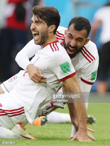 Karim Ansarifard and Rouzbeh Cheshmi of Iran celebrate at full time during the 2018 FIFA World Cup Russia group B match between Morocco and Iran at...