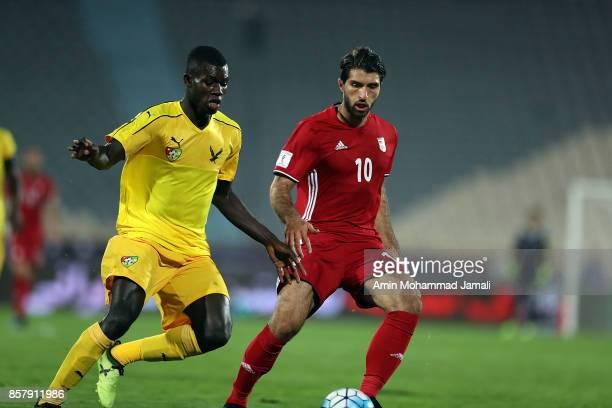 Karim Ansarifard of Iran and Ortega Djene in action during the international friendly match between Iran and Togo at Azadi Stadium on October 5 2017...