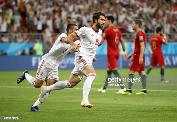 Karim Ansarifard of Iran celebrates after he scores his team's first goal from the peanlty spot during the 2018 FIFA World Cup Russia group B match...