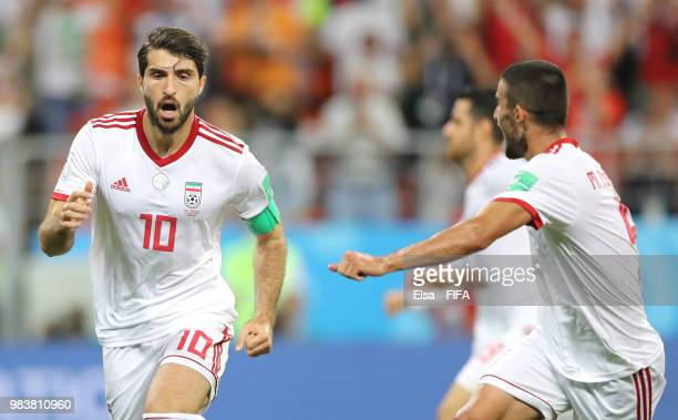 Karim Ansarifard of Iran celebrates with teammate Milad Mohammadi after scoring his team's first goal during the 2018 FIFA World Cup Russia group B...